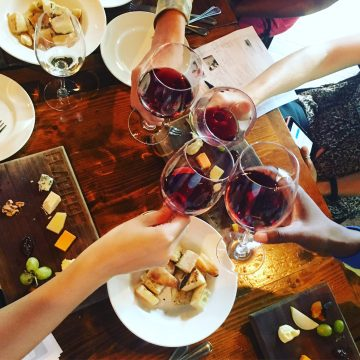 a wine toast and cheese boards